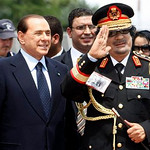 Libyan leader Moammar Gadhafi, right,  salutes as he is greeted by Italian Premier Silvio Berlusconi upon his arrival at Rome's Ciampino military airport, Wednesday, June 10, 2009. Gadhafi h ...